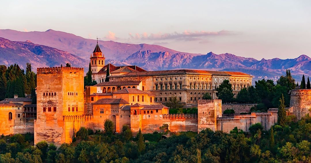 The sun turns the Alhambra palace in Granada Spain orangehellip