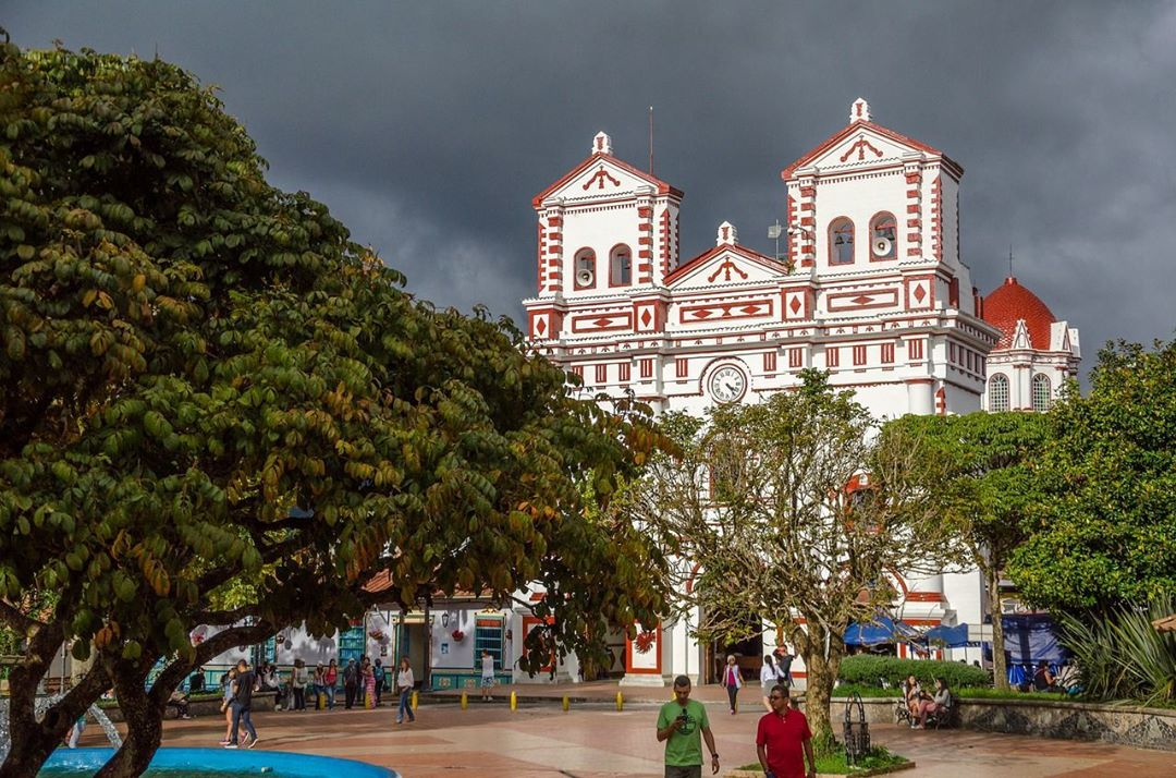 Beautiful colonial church and lively square in Guatape Colombia colombiahellip